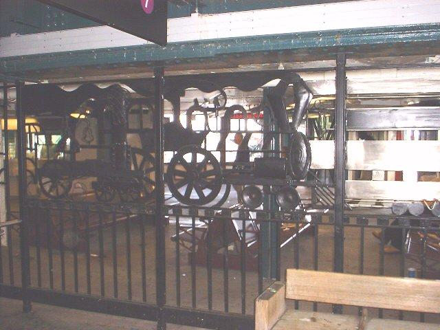 (66k, 640x480)<br><b>Country:</b> United States<br><b>City:</b> New York<br><b>System:</b> New York City Transit<br><b>Line:</b> IRT Flushing Line<br><b>Location:</b> 61st Street/Woodside <br><b>Photo by:</b> Peggy Darlington<br><b>Date:</b> 5/17/2000<br><b>Artwork:</b> <i>Woodside Continuum</i>, Dimitri Gerakaris (1999).<br><b>Viewed (this week/total):</b> 5 / 2938