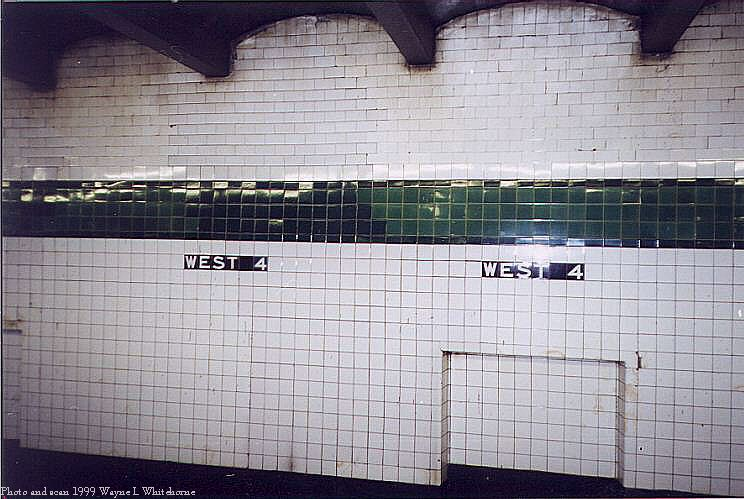 (79k, 744x499)<br><b>Country:</b> United States<br><b>City:</b> New York<br><b>System:</b> New York City Transit<br><b>Line:</b> IND 8th Avenue Line<br><b>Location:</b> West 4th Street/Washington Square <br><b>Photo by:</b> Wayne Whitehorne<br><b>Date:</b> 2/11/1999<br><b>Notes:</b> Upper level - wall tile with patch<br><b>Viewed (this week/total):</b> 1 / 2000