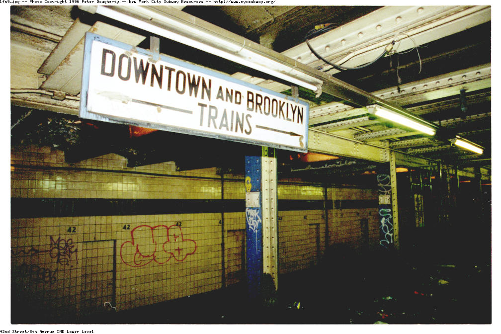 (143k, 1008x672)<br><b>Country:</b> United States<br><b>City:</b> New York<br><b>System:</b> New York City Transit<br><b>Line:</b> IND 8th Avenue Line<br><b>Location:</b> 42nd Street/Port Authority Bus Terminal (Lower Level) <br><b>Photo by:</b> Peter Dougherty<br><b>Date:</b> 1997<br><b>Notes:</b> Close-up of another old-style TA sign. It is believed there was once, long ago, a passageway from the uptown platform to this lower-level platform. This sign would have greeted travelers emerging from this passageway.<br><b>Viewed (this week/total):</b> 3 / 16251