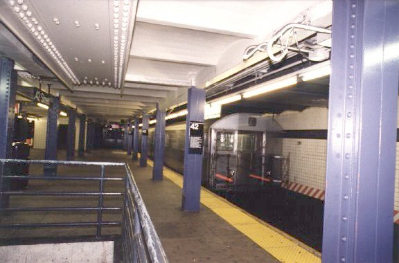 (47k, 576x380)<br><b>Country:</b> United States<br><b>City:</b> New York<br><b>System:</b> New York City Transit<br><b>Line:</b> IND 8th Avenue Line<br><b>Location:</b> 42nd Street/Port Authority Bus Terminal <br><b>Photo by:</b> Peter Dougherty<br><b>Date:</b> 1997<br><b>Notes:</b> Southbound platform facing south<br><b>Viewed (this week/total):</b> 3 / 5931