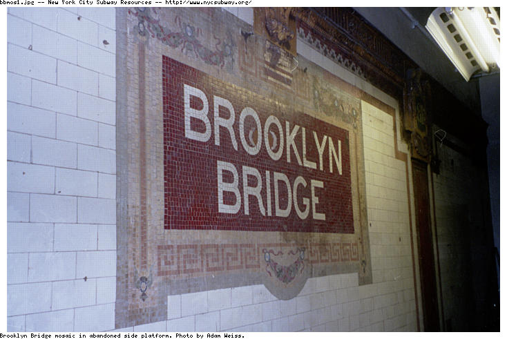 (66k, 734x491)<br><b>Country:</b> United States<br><b>City:</b> New York<br><b>System:</b> New York City Transit<br><b>Line:</b> IRT East Side Line<br><b>Location:</b> Brooklyn Bridge/City Hall (Closed Side Platform) <br><b>Photo by:</b> Adam Weiss<br><b>Date:</b> 10/1995<br><b>Notes:</b> Brooklyn Bridge mosaic in abandoned side platform<br><b>Viewed (this week/total):</b> 1 / 8852