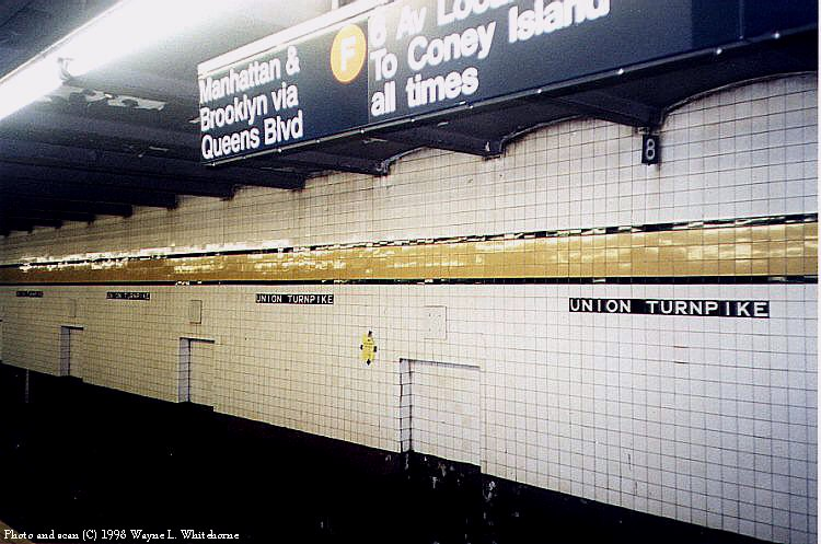 (89k, 750x497)<br><b>Country:</b> United States<br><b>City:</b> New York<br><b>System:</b> New York City Transit<br><b>Line:</b> IND Queens Boulevard Line<br><b>Location:</b> Union Turnpike/Kew Gardens <br><b>Photo by:</b> Wayne Whitehorne<br><b>Date:</b> 4/18/1998<br><b>Viewed (this week/total):</b> 2 / 3087