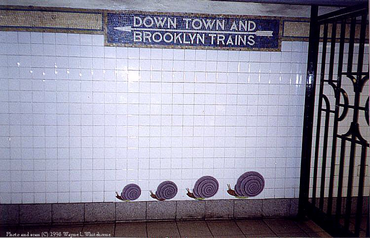 (91k, 750x484)<br><b>Country:</b> United States<br><b>City:</b> New York<br><b>System:</b> New York City Transit<br><b>Line:</b> BMT Broadway Line<br><b>Location:</b> 5th Avenue <br><b>Photo by:</b> Wayne Whitehorne<br><b>Date:</b> 9/19/1998<br><b>Artwork:</b> <i>Urban Oasis</i>, Ann Schaumburger (1997).<br><b>Notes:</b> Art installation, snails panel.<br><b>Viewed (this week/total):</b> 0 / 3801