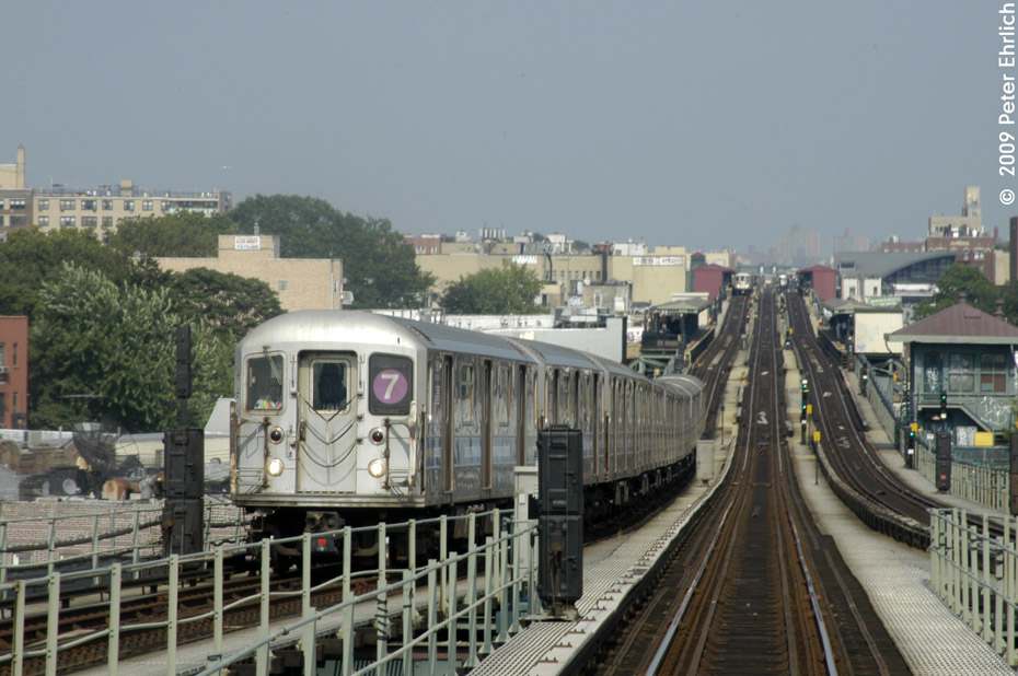 (195k, 930x618)<br><b>Country:</b> United States<br><b>City:</b> New York<br><b>System:</b> New York City Transit<br><b>Line:</b> IRT Flushing Line<br><b>Location:</b> 61st Street/Woodside <br><b>Route:</b> 7<br><b>Car:</b> R-62A (Bombardier, 1984-1987)  1680 <br><b>Photo by:</b> Peter Ehrlich<br><b>Date:</b> 7/22/2009<br><b>Notes:</b> Approaching 61st Street, inbound.  Another inbound train is visible at 74th Street.<br><b>Viewed (this week/total):</b> 2 / 1017