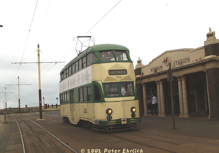 (106k, 720x504)<br><b>Country:</b> United Kingdom<br><b>City:</b> Blackpool<br><b>System:</b> Blackpool Transport<br><b>Car:</b> Blackpool Balloon (English Electric, 1934-1935)  710 <br><b>Photo by:</b> Peter Ehrlich<br><b>Date:</b> 6/30/2002<br><b>Notes:</b> A typical Blackpool tram--a double-decker Balloon, 710, heading northbound (toward Fleetwood) at Bispham Station.<br><b>Viewed (this week/total):</b> 3 / 2375