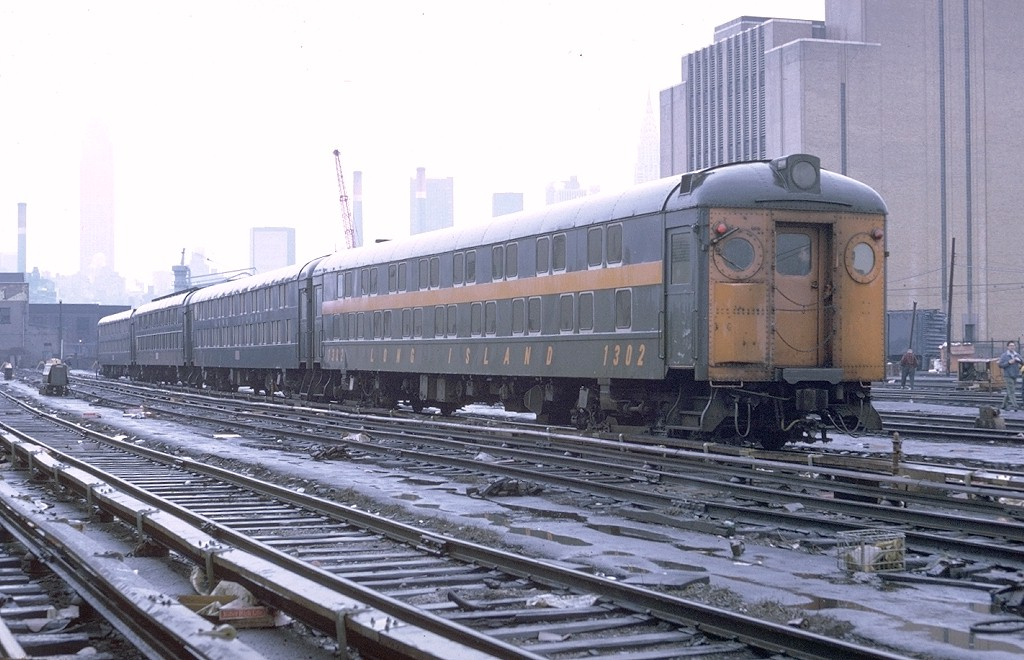 (189k, 1024x660)<br><b>Country:</b> United States<br><b>City:</b> New York<br><b>System:</b> Long Island Rail Road<br><b>Line:</b> LIRR Long Island City<br><b>Location:</b> Long Island City <br><b>Car:</b> LIRR MP70B  1302 <br><b>Photo by:</b> Doug Grotjahn<br><b>Collection of:</b> Joe Testagrose<br><b>Date:</b> 5/8/1971<br><b>Viewed (this week/total):</b> 6 / 2988