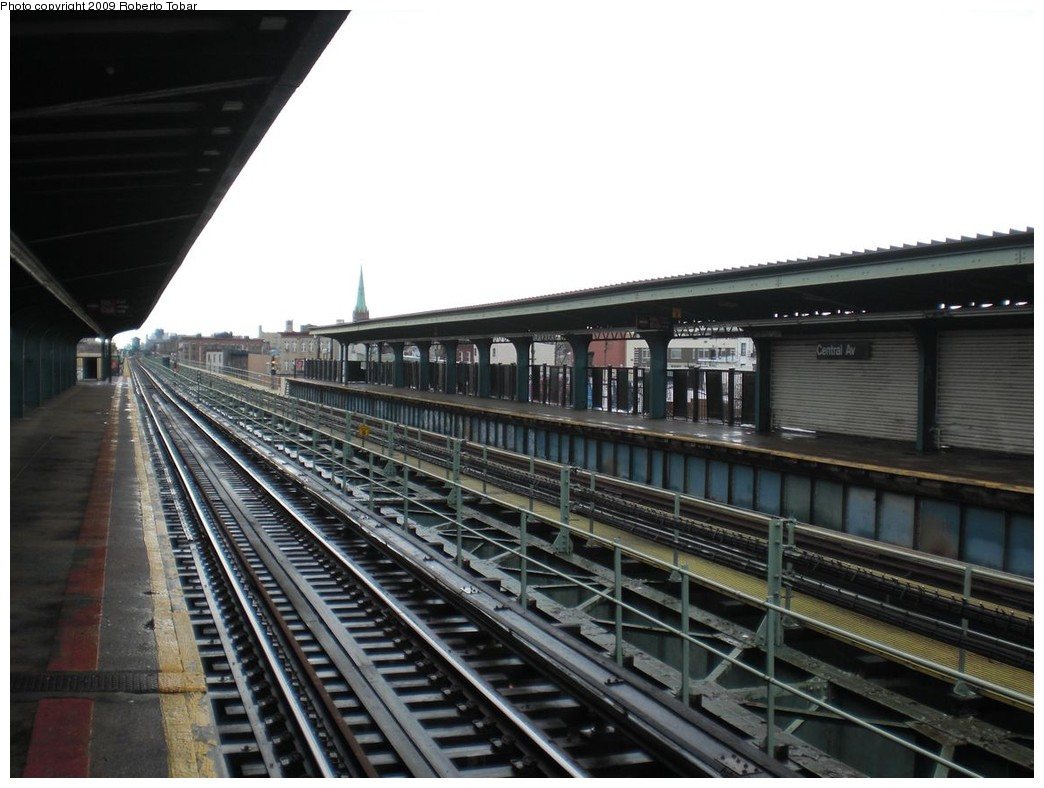 (217k, 1044x788)<br><b>Country:</b> United States<br><b>City:</b> New York<br><b>System:</b> New York City Transit<br><b>Line:</b> BMT Myrtle Avenue Line<br><b>Location:</b> Central Avenue <br><b>Photo by:</b> Roberto C. Tobar<br><b>Date:</b> 4/11/2009<br><b>Notes:</b> Platform view.<br><b>Viewed (this week/total):</b> 0 / 604