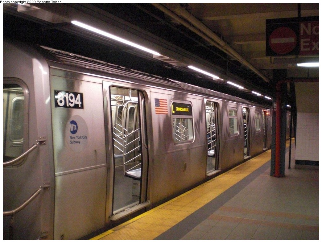 (252k, 1044x788)<br><b>Country:</b> United States<br><b>City:</b> New York<br><b>System:</b> New York City Transit<br><b>Line:</b> BMT Canarsie Line<br><b>Location:</b> Myrtle Avenue <br><b>Route:</b> L<br><b>Car:</b> R-143 (Kawasaki, 2001-2002) 8194 <br><b>Photo by:</b> Roberto C. Tobar<br><b>Date:</b> 4/11/2009<br><b>Viewed (this week/total):</b> 0 / 973