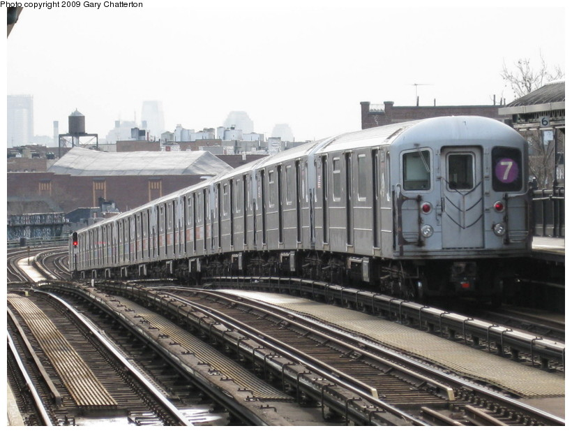 (139k, 820x620)<br><b>Country:</b> United States<br><b>City:</b> New York<br><b>System:</b> New York City Transit<br><b>Line:</b> IRT Flushing Line<br><b>Location:</b> 52nd Street/Lincoln Avenue <br><b>Route:</b> 7<br><b>Car:</b> R-62A (Bombardier, 1984-1987)  2086 <br><b>Photo by:</b> Gary Chatterton<br><b>Date:</b> 4/15/2009<br><b>Viewed (this week/total):</b> 0 / 723