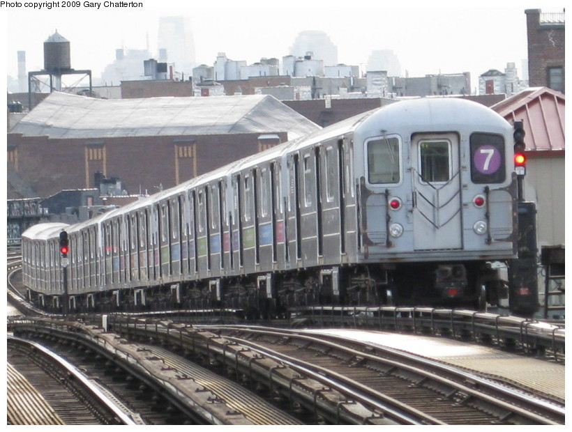 (142k, 820x620)<br><b>Country:</b> United States<br><b>City:</b> New York<br><b>System:</b> New York City Transit<br><b>Line:</b> IRT Flushing Line<br><b>Location:</b> 52nd Street/Lincoln Avenue <br><b>Route:</b> 7<br><b>Car:</b> R-62A (Bombardier, 1984-1987)  2064 <br><b>Photo by:</b> Gary Chatterton<br><b>Date:</b> 4/15/2009<br><b>Viewed (this week/total):</b> 0 / 703