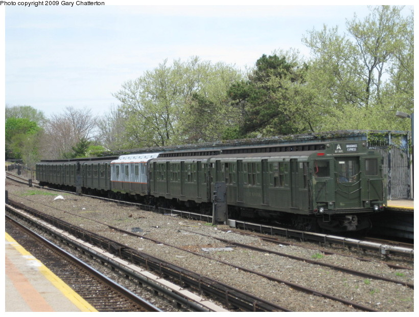 (165k, 820x620)<br><b>Country:</b> United States<br><b>City:</b> New York<br><b>System:</b> New York City Transit<br><b>Line:</b> IND Rockaway<br><b>Location:</b> Aqueduct/North Conduit Avenue <br><b>Route:</b> Museum Train Service (A)<br><b>Car:</b> R-1 (American Car & Foundry, 1930-1931) 100 <br><b>Photo by:</b> Gary Chatterton<br><b>Date:</b> 4/29/2009<br><b>Notes:</b> Duke Ellington Day promotion by Jet Blue & the Bahamas.<br><b>Viewed (this week/total):</b> 2 / 933