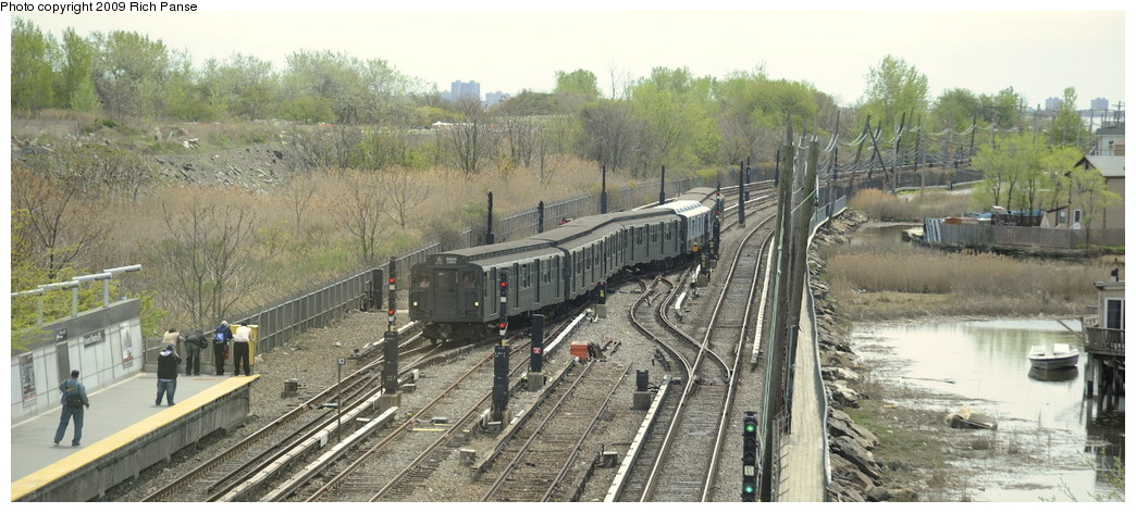 (175k, 1044x472)<br><b>Country:</b> United States<br><b>City:</b> New York<br><b>System:</b> New York City Transit<br><b>Line:</b> IND Rockaway<br><b>Location:</b> Howard Beach <br><b>Route:</b> Museum Train Service (A)<br><b>Car:</b> R-1 (American Car & Foundry, 1930-1931) 100 <br><b>Photo by:</b> Richard Panse<br><b>Date:</b> 4/29/2009<br><b>Viewed (this week/total):</b> 2 / 1893