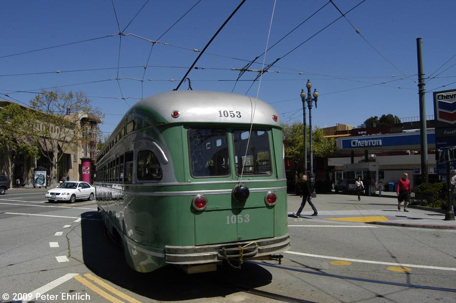 (190k, 930x618)<br><b>Country:</b> United States<br><b>City:</b> San Francisco/Bay Area, CA<br><b>System:</b> SF MUNI<br><b>Location:</b> Market/17th/Castro <br><b>Car:</b> SF MUNI PCC (Ex-SEPTA) (St. Louis Car Co., 1947-1948)  1053 <br><b>Photo by:</b> Peter Ehrlich<br><b>Date:</b> 4/4/2009<br><b>Notes:</b> Leaving 17th Street/Castro Terminal.<br><b>Viewed (this week/total):</b> 0 / 261