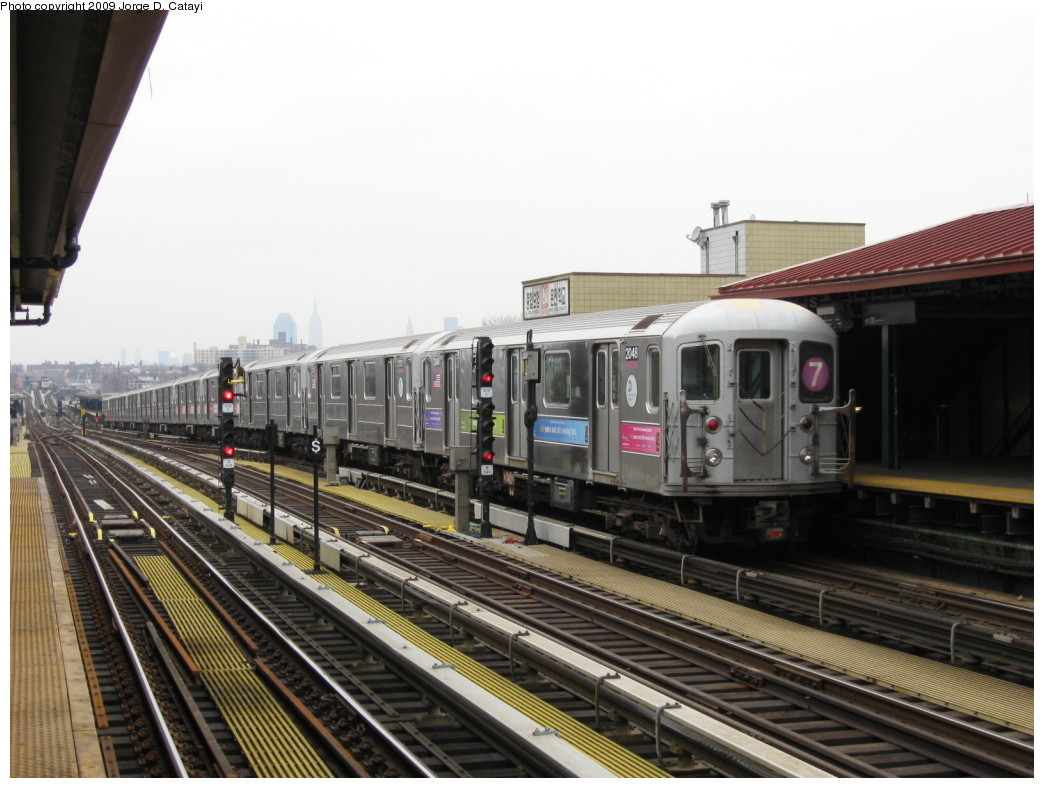 (193k, 1044x788)<br><b>Country:</b> United States<br><b>City:</b> New York<br><b>System:</b> New York City Transit<br><b>Line:</b> IRT Flushing Line<br><b>Location:</b> 74th Street/Broadway <br><b>Route:</b> 7<br><b>Car:</b> R-62A (Bombardier, 1984-1987)  2048 <br><b>Photo by:</b> Jorge Catayi<br><b>Date:</b> 3/15/2009<br><b>Viewed (this week/total):</b> 1 / 1107