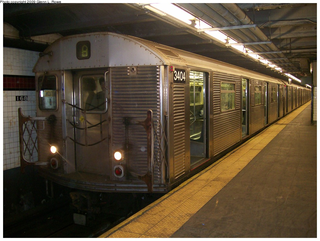 (214k, 1044x788)<br><b>Country:</b> United States<br><b>City:</b> New York<br><b>System:</b> New York City Transit<br><b>Line:</b> IND 8th Avenue Line<br><b>Location:</b> 168th Street <br><b>Route:</b> A<br><b>Car:</b> R-32 (Budd, 1964)  3404 <br><b>Photo by:</b> Glenn L. Rowe<br><b>Date:</b> 5/21/2009<br><b>Viewed (this week/total):</b> 2 / 458