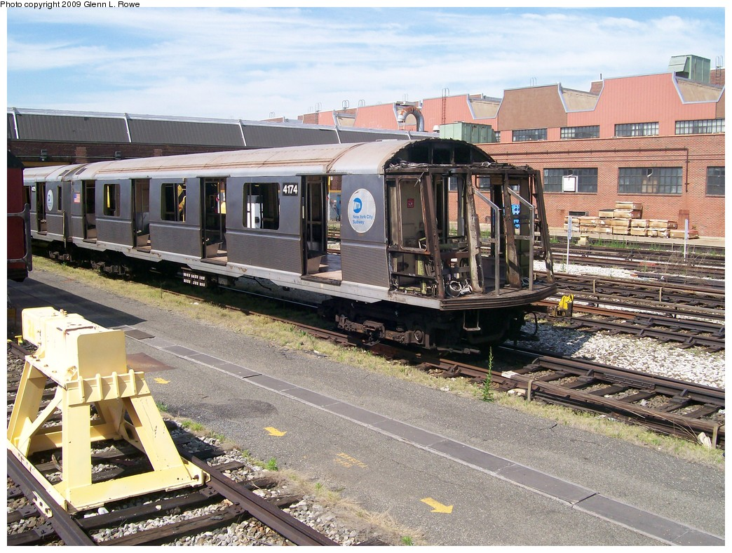 (288k, 1044x788)<br><b>Country:</b> United States<br><b>City:</b> New York<br><b>System:</b> New York City Transit<br><b>Location:</b> 207th Street Yard<br><b>Car:</b> R-40 (St. Louis, 1968)  4174 <br><b>Photo by:</b> Glenn L. Rowe<br><b>Date:</b> 5/22/2009<br><b>Notes:</b> Scrap<br><b>Viewed (this week/total):</b> 0 / 903