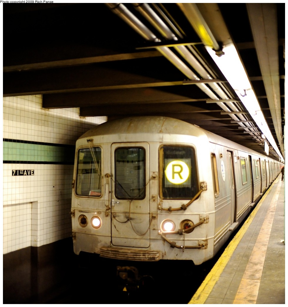 (196k, 979x1044)<br><b>Country:</b> United States<br><b>City:</b> New York<br><b>System:</b> New York City Transit<br><b>Line:</b> IND Queens Boulevard Line<br><b>Location:</b> 71st/Continental Aves./Forest Hills <br><b>Route:</b> R<br><b>Car:</b> R-46 (Pullman-Standard, 1974-75)  <br><b>Photo by:</b> Richard Panse<br><b>Date:</b> 3/25/2009<br><b>Viewed (this week/total):</b> 0 / 489