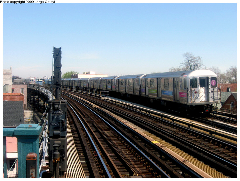 (193k, 820x620)<br><b>Country:</b> United States<br><b>City:</b> New York<br><b>System:</b> New York City Transit<br><b>Line:</b> IRT Flushing Line<br><b>Location:</b> 103rd Street/Corona Plaza <br><b>Route:</b> 7<br><b>Car:</b> R-62A (Bombardier, 1984-1987)  1671 <br><b>Photo by:</b> Jorge Catayi<br><b>Date:</b> 4/25/2009<br><b>Viewed (this week/total):</b> 0 / 529