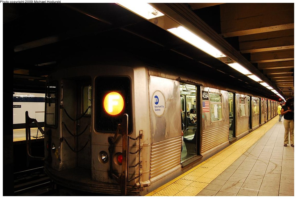 (208k, 1044x699)<br><b>Country:</b> United States<br><b>City:</b> New York<br><b>System:</b> New York City Transit<br><b>Line:</b> IND Queens Boulevard Line<br><b>Location:</b> Roosevelt Avenue <br><b>Route:</b> F<br><b>Car:</b> R-42 (St. Louis, 1969-1970)  4594 <br><b>Photo by:</b> Michael Hodurski<br><b>Date:</b> 4/26/2009<br><b>Viewed (this week/total):</b> 2 / 1079