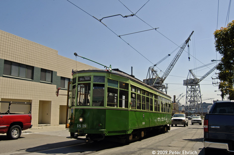 (194k, 930x618)<br><b>Country:</b> United States<br><b>City:</b> San Francisco/Bay Area, CA<br><b>System:</b> SF MUNI<br><b>Line:</b> MUNI 3rd Street Light Rail<br><b>Location:</b> 19th St. (Loop) <br><b>Car:</b> Milan Milano/Peter Witt (1927-1930)  1818 <br><b>Photo by:</b> Peter Ehrlich<br><b>Date:</b> 5/26/2009<br><b>Notes:</b> This is part of the unfinished Illinois Loop.  The cranes of the Union Iron Works Historic District are in the background.<br><b>Viewed (this week/total):</b> 1 / 695