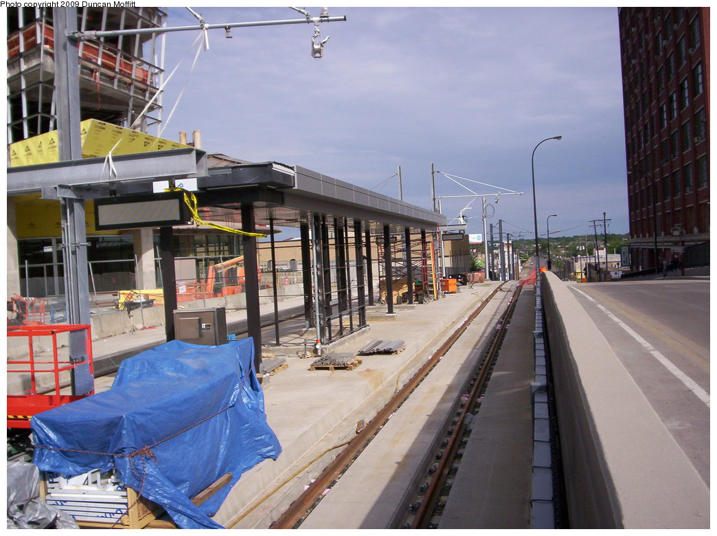 (248k, 1044x780)<br><b>Country:</b> United States<br><b>City:</b> Minneapolis, MN<br><b>System:</b> MNDOT Light Rail Transit<br><b>Line:</b> Hiawatha Line<br><b>Location:</b> <b>Downtown Minneapolis Ballpark</b> <br><b>Photo by:</b> Duncan Moffitt<br><b>Date:</b> 5/25/2009<br><b>Notes:</b> Looking northwestward along N. 5th St. in May as construction progresses. The digital signs have been mounted and pulleys for stringing the wire are in place.<br><b>Viewed (this week/total):</b> 1 / 235