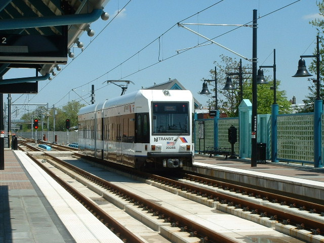 (156k, 640x480)<br><b>Country:</b> United States<br><b>City:</b> Bayonne, NJ<br><b>System:</b> Hudson Bergen Light Rail<br><b>Location:</b> East 22nd Street <br><b>Car:</b> NJT-HBLR LRV (Kinki-Sharyo, 1998-99)  2028 <br><b>Photo by:</b> Brian J. Cudahy<br><b>Date:</b> 5/4/2004<br><b>Viewed (this week/total):</b> 2 / 250
