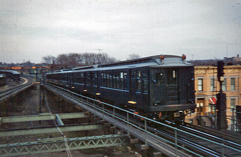 (251k, 784x509)<br><b>Country:</b> United States<br><b>City:</b> New York<br><b>System:</b> New York City Transit<br><b>Line:</b> BMT Myrtle Avenue Line<br><b>Location:</b> Fresh Pond Road <br><b>Car:</b> BMT Q  <br><b>Photo by:</b> Brian J. Cudahy<br><b>Date:</b> 1959<br><b>Notes:</b> 1600-series Q units on Myrtle at Fresh Pond ca before clerestory roofs were lowered<br><b>Viewed (this week/total):</b> 4 / 1255
