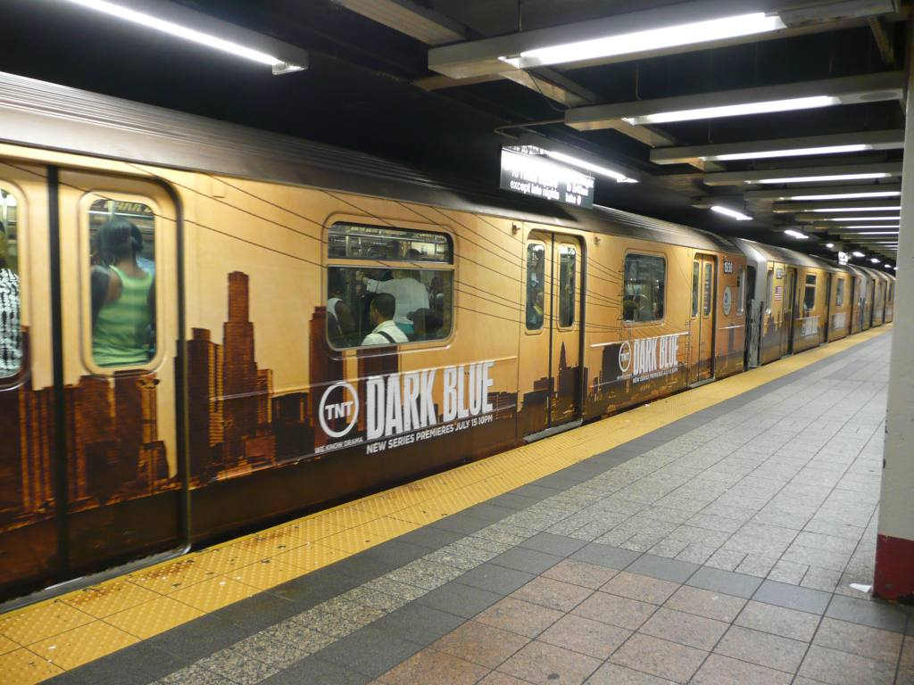 (135k, 1024x768)<br><b>Country:</b> United States<br><b>City:</b> New York<br><b>System:</b> New York City Transit<br><b>Line:</b> IRT Times Square-Grand Central Shuttle<br><b>Location:</b> Grand Central <br><b>Photo by:</b> Robbie Rosenfeld<br><b>Date:</b> 7/16/2009<br><b>Notes:</b> Shuttle ad wrap for tv show Dark Blue.<br><b>Viewed (this week/total):</b> 0 / 662