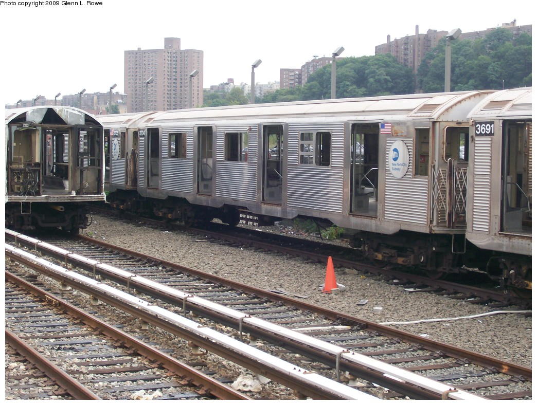 (262k, 1044x788)<br><b>Country:</b> United States<br><b>City:</b> New York<br><b>System:</b> New York City Transit<br><b>Location:</b> 207th Street Yard<br><b>Car:</b> R-32 (Budd, 1964)  3704 <br><b>Photo by:</b> Glenn L. Rowe<br><b>Date:</b> 9/23/2009<br><b>Notes:</b> Scrap<br><b>Viewed (this week/total):</b> 1 / 826