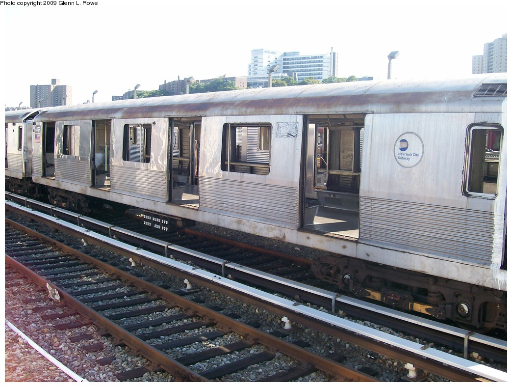 (233k, 1044x788)<br><b>Country:</b> United States<br><b>City:</b> New York<br><b>System:</b> New York City Transit<br><b>Location:</b> 207th Street Yard<br><b>Car:</b> R-42 (St. Louis, 1969-1970)  4599 <br><b>Photo by:</b> Glenn L. Rowe<br><b>Date:</b> 9/29/2009<br><b>Notes:</b> Scrap<br><b>Viewed (this week/total):</b> 0 / 543