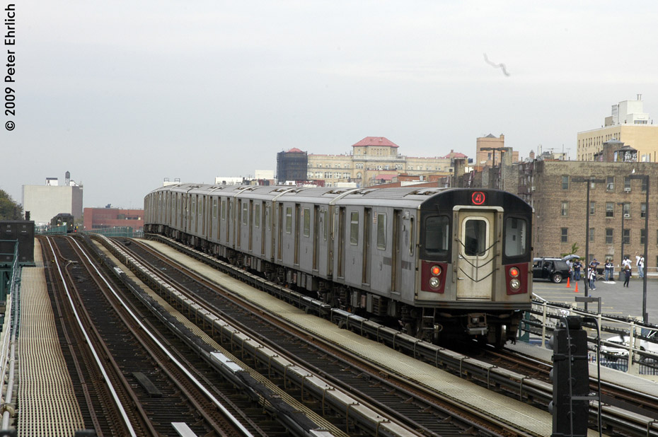 (207k, 930x618)<br><b>Country:</b> United States<br><b>City:</b> New York<br><b>System:</b> New York City Transit<br><b>Line:</b> IRT Woodlawn Line<br><b>Location:</b> 161st Street/River Avenue (Yankee Stadium) <br><b>Route:</b> 4<br><b>Car:</b> R-142 (Option Order, Bombardier, 2002-2003)  1165 <br><b>Photo by:</b> Peter Ehrlich<br><b>Date:</b> 10/9/2009<br><b>Notes:</b> Outbound. Trailing view.  Lo-V 4292 is in the background on the center track.<br><b>Viewed (this week/total):</b> 3 / 1060
