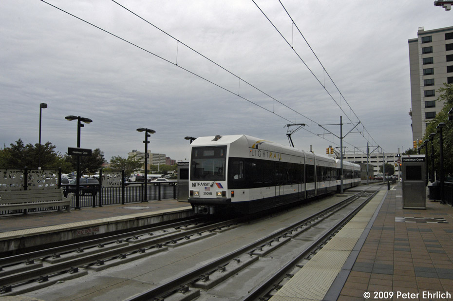 (180k, 930x618)<br><b>Country:</b> United States<br><b>City:</b> Jersey City, NJ<br><b>System:</b> Hudson Bergen Light Rail<br><b>Location:</b> Harsimus Cove <br><b>Car:</b> NJT-HBLR LRV (Kinki-Sharyo, 1998-99)  2009 <br><b>Photo by:</b> Peter Ehrlich<br><b>Date:</b> 10/9/2009<br><b>Notes:</b> Outbound.<br><b>Viewed (this week/total):</b> 1 / 141