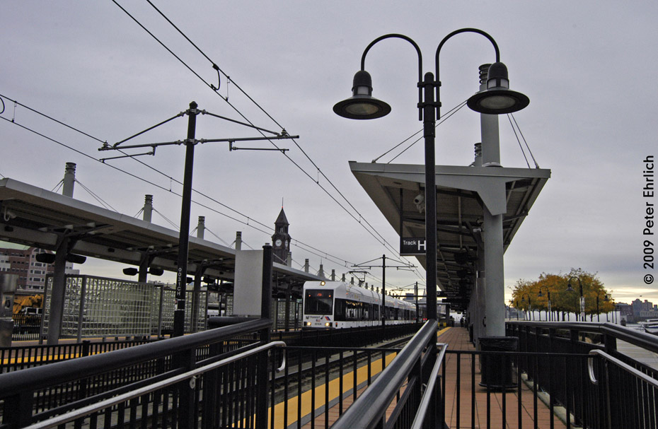 (194k, 930x607)<br><b>Country:</b> United States<br><b>City:</b> Hoboken, NJ<br><b>System:</b> Hudson Bergen Light Rail<br><b>Location:</b> Hoboken <br><b>Car:</b> NJT-HBLR LRV (Kinki-Sharyo, 1998-99)  2012 <br><b>Photo by:</b> Peter Ehrlich<br><b>Date:</b> 10/9/2009<br><b>Viewed (this week/total):</b> 0 / 119
