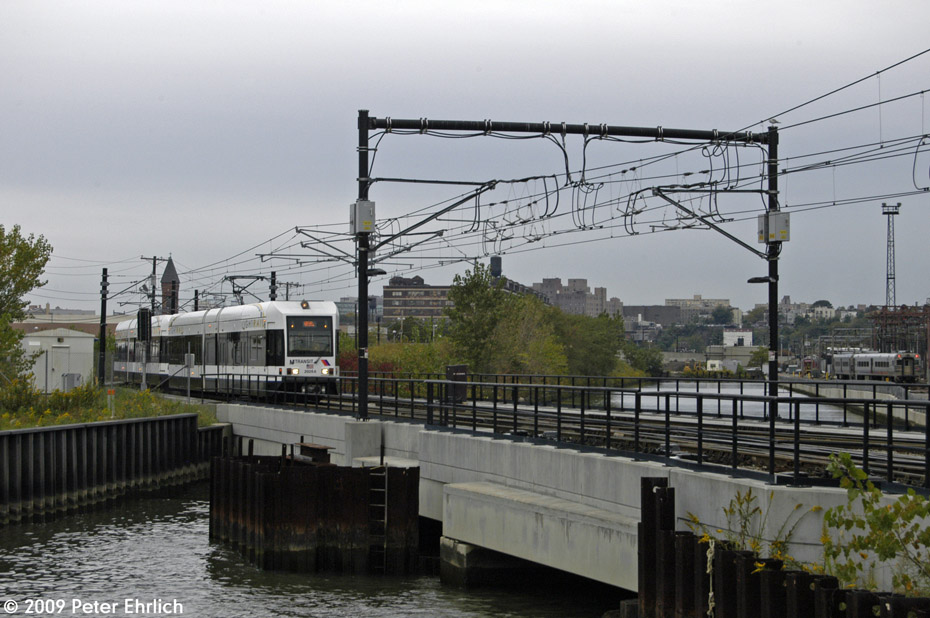 (192k, 930x618)<br><b>Country:</b> United States<br><b>City:</b> Hoboken, NJ<br><b>System:</b> Hudson Bergen Light Rail<br><b>Location:</b> Hoboken <br><b>Car:</b> NJT-HBLR LRV (Kinki-Sharyo, 1998-99)  2026 <br><b>Photo by:</b> Peter Ehrlich<br><b>Date:</b> 10/9/2009<br><b>Viewed (this week/total):</b> 2 / 159