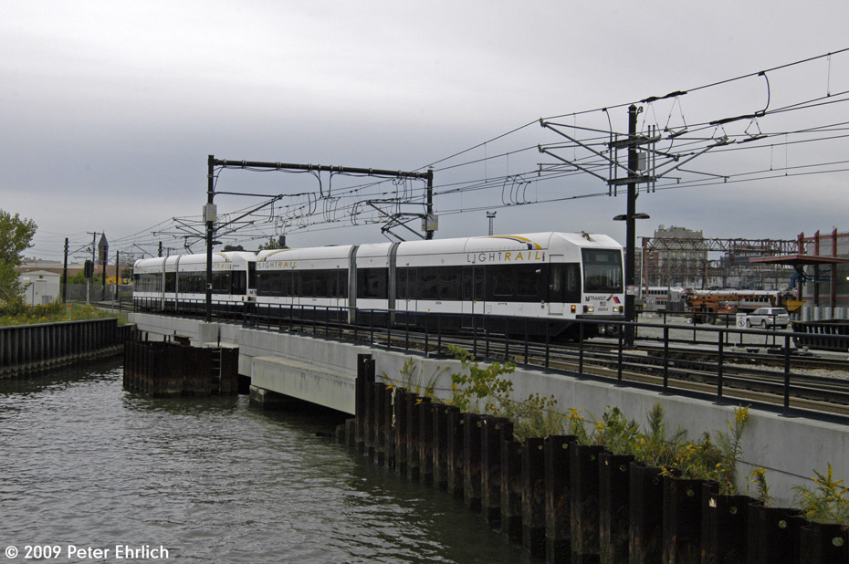 (196k, 930x618)<br><b>Country:</b> United States<br><b>City:</b> Hoboken, NJ<br><b>System:</b> Hudson Bergen Light Rail<br><b>Location:</b> Hoboken <br><b>Car:</b> NJT-HBLR LRV (Kinki-Sharyo, 1998-99)  2026 <br><b>Photo by:</b> Peter Ehrlich<br><b>Date:</b> 10/9/2009<br><b>Viewed (this week/total):</b> 0 / 156