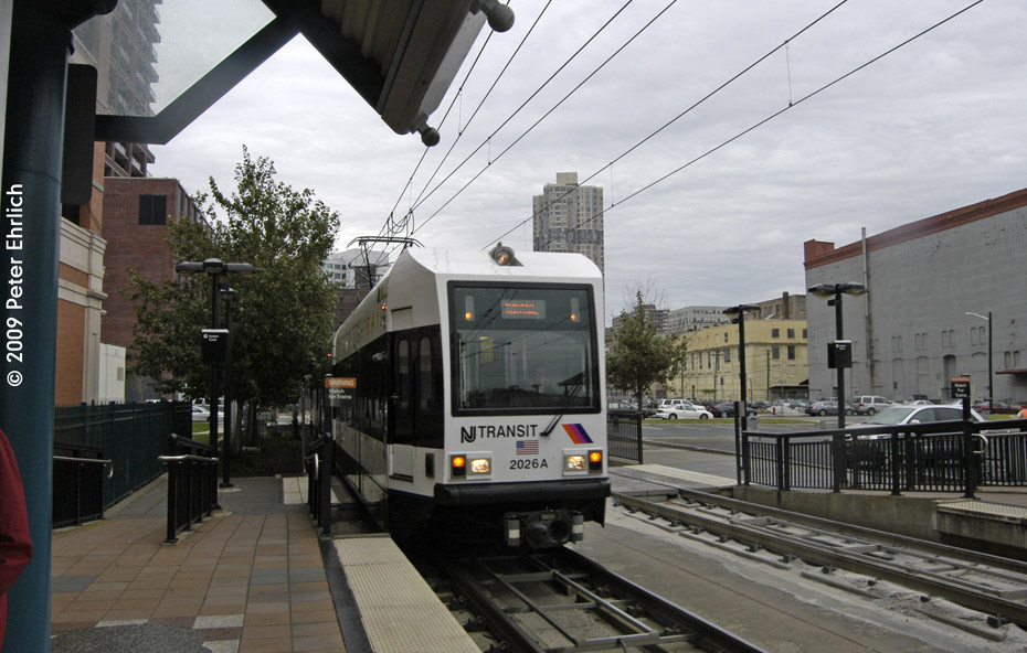(197k, 930x592)<br><b>Country:</b> United States<br><b>City:</b> Jersey City, NJ<br><b>System:</b> Hudson Bergen Light Rail<br><b>Location:</b> Harsimus Cove <br><b>Car:</b> NJT-HBLR LRV (Kinki-Sharyo, 1998-99)  2026 <br><b>Photo by:</b> Peter Ehrlich<br><b>Date:</b> 10/9/2009<br><b>Notes:</b> Inbound.<br><b>Viewed (this week/total):</b> 0 / 297