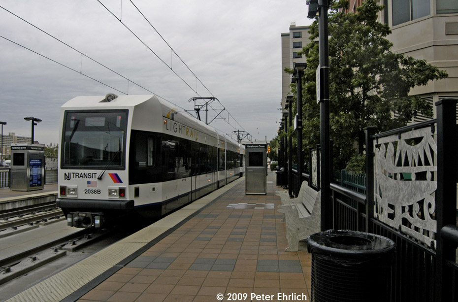 (201k, 930x613)<br><b>Country:</b> United States<br><b>City:</b> Jersey City, NJ<br><b>System:</b> Hudson Bergen Light Rail<br><b>Location:</b> Harsimus Cove <br><b>Car:</b> NJT-HBLR LRV (Kinki-Sharyo, 1998-99)  2038 <br><b>Photo by:</b> Peter Ehrlich<br><b>Date:</b> 10/9/2009<br><b>Notes:</b> Inbound.<br><b>Viewed (this week/total):</b> 0 / 111