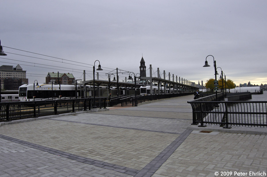 (169k, 930x618)<br><b>Country:</b> United States<br><b>City:</b> Hoboken, NJ<br><b>System:</b> Hudson Bergen Light Rail<br><b>Location:</b> Hoboken <br><b>Car:</b> NJT-HBLR LRV (Kinki-Sharyo, 1998-99)  2043 <br><b>Photo by:</b> Peter Ehrlich<br><b>Date:</b> 10/9/2009<br><b>Viewed (this week/total):</b> 2 / 171