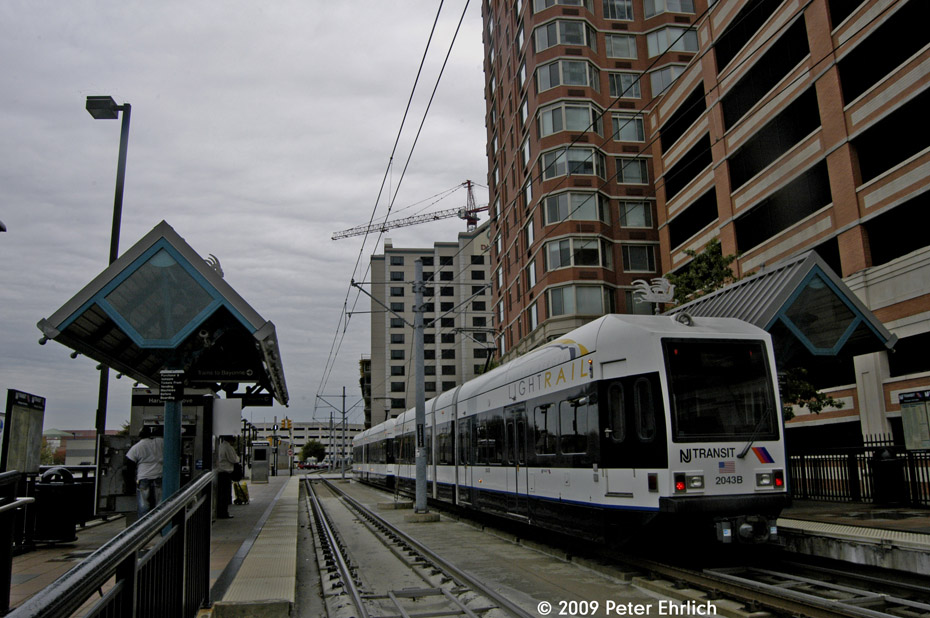 (210k, 930x618)<br><b>Country:</b> United States<br><b>City:</b> Jersey City, NJ<br><b>System:</b> Hudson Bergen Light Rail<br><b>Location:</b> Harsimus Cove <br><b>Car:</b> NJT-HBLR LRV (Kinki-Sharyo, 1998-99)  2043 <br><b>Photo by:</b> Peter Ehrlich<br><b>Date:</b> 10/9/2009<br><b>Notes:</b> Inbound.<br><b>Viewed (this week/total):</b> 0 / 236