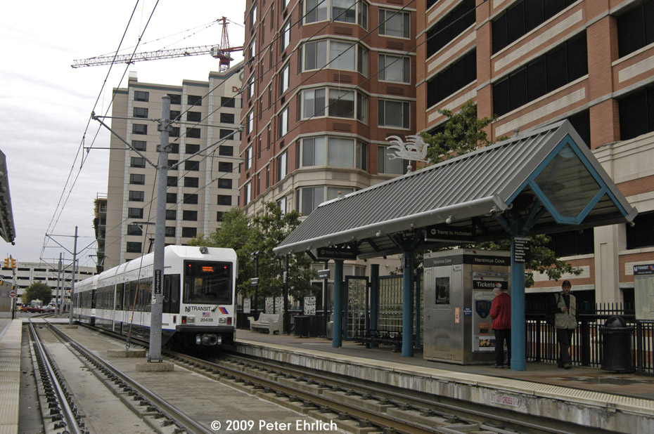 (242k, 930x618)<br><b>Country:</b> United States<br><b>City:</b> Jersey City, NJ<br><b>System:</b> Hudson Bergen Light Rail<br><b>Location:</b> Harsimus Cove <br><b>Car:</b> NJT-HBLR LRV (Kinki-Sharyo, 1998-99)  2043 <br><b>Photo by:</b> Peter Ehrlich<br><b>Date:</b> 10/9/2009<br><b>Notes:</b> Inbound.<br><b>Viewed (this week/total):</b> 0 / 360