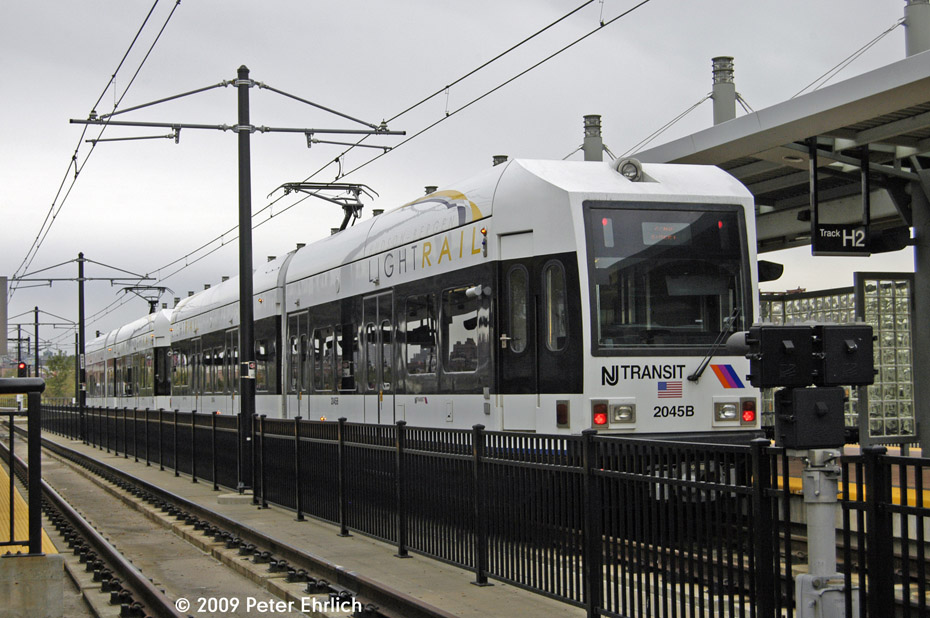 (209k, 930x618)<br><b>Country:</b> United States<br><b>City:</b> Hoboken, NJ<br><b>System:</b> Hudson Bergen Light Rail<br><b>Location:</b> Hoboken <br><b>Car:</b> NJT-HBLR LRV (Kinki-Sharyo, 1998-99)  2045 <br><b>Photo by:</b> Peter Ehrlich<br><b>Date:</b> 10/9/2009<br><b>Viewed (this week/total):</b> 3 / 368