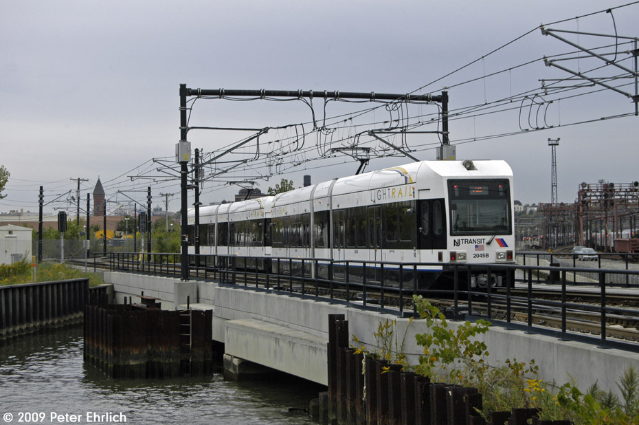 (205k, 930x618)<br><b>Country:</b> United States<br><b>City:</b> Hoboken, NJ<br><b>System:</b> Hudson Bergen Light Rail<br><b>Location:</b> Hoboken <br><b>Car:</b> NJT-HBLR LRV (Kinki-Sharyo, 1998-99)  2045 <br><b>Photo by:</b> Peter Ehrlich<br><b>Date:</b> 10/9/2009<br><b>Viewed (this week/total):</b> 0 / 269