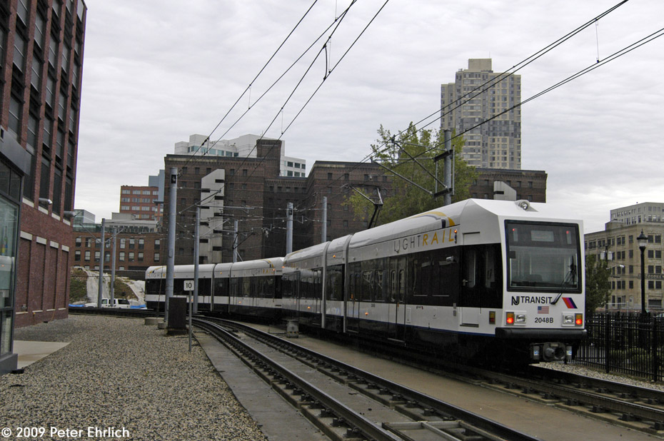 (220k, 930x618)<br><b>Country:</b> United States<br><b>City:</b> Jersey City, NJ<br><b>System:</b> Hudson Bergen Light Rail<br><b>Location:</b> Harsimus Cove <br><b>Car:</b> NJT-HBLR LRV (Kinki-Sharyo, 1998-99)  2048 <br><b>Photo by:</b> Peter Ehrlich<br><b>Date:</b> 10/9/2009<br><b>Notes:</b> Outbound.<br><b>Viewed (this week/total):</b> 2 / 241