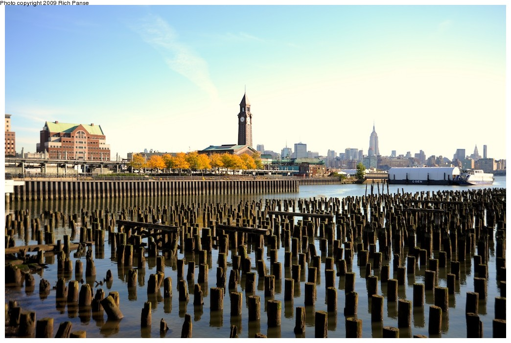 (188k, 1044x701)<br><b>Country:</b> United States<br><b>City:</b> Hoboken, NJ<br><b>System:</b> Hudson Bergen Light Rail<br><b>Location:</b> Hoboken <br><b>Photo by:</b> Richard Panse<br><b>Date:</b> 10/11/2009<br><b>Notes:</b> View from Hudson walkway. HBLR station on left, main terminal and clock tower at center.<br><b>Viewed (this week/total):</b> 0 / 200