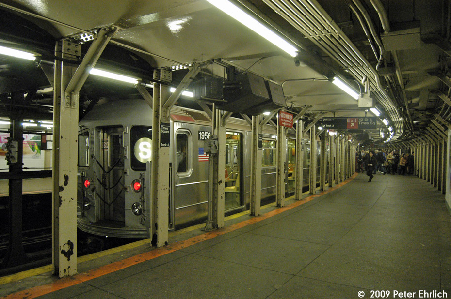 (225k, 930x618)<br><b>Country:</b> United States<br><b>City:</b> New York<br><b>System:</b> New York City Transit<br><b>Line:</b> IRT Times Square-Grand Central Shuttle<br><b>Location:</b> Times Square <br><b>Route:</b> S<br><b>Car:</b> R-62A (Bombardier, 1984-1987)  1956 <br><b>Photo by:</b> Peter Ehrlich<br><b>Date:</b> 10/30/2009<br><b>Viewed (this week/total):</b> 1 / 805