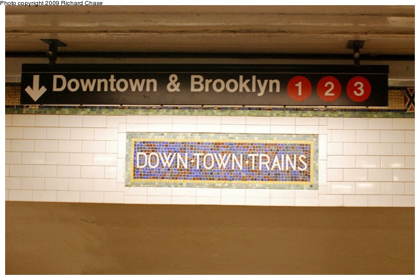 (101k, 820x547)<br><b>Country:</b> United States<br><b>City:</b> New York<br><b>System:</b> New York City Transit<br><b>Line:</b> IRT West Side Line<br><b>Location:</b> 34th Street/Penn Station <br><b>Photo by:</b> Richard Chase<br><b>Date:</b> 10/28/2009<br><b>Notes:</b> Downtown mosaic and signage.<br><b>Viewed (this week/total):</b> 4 / 535