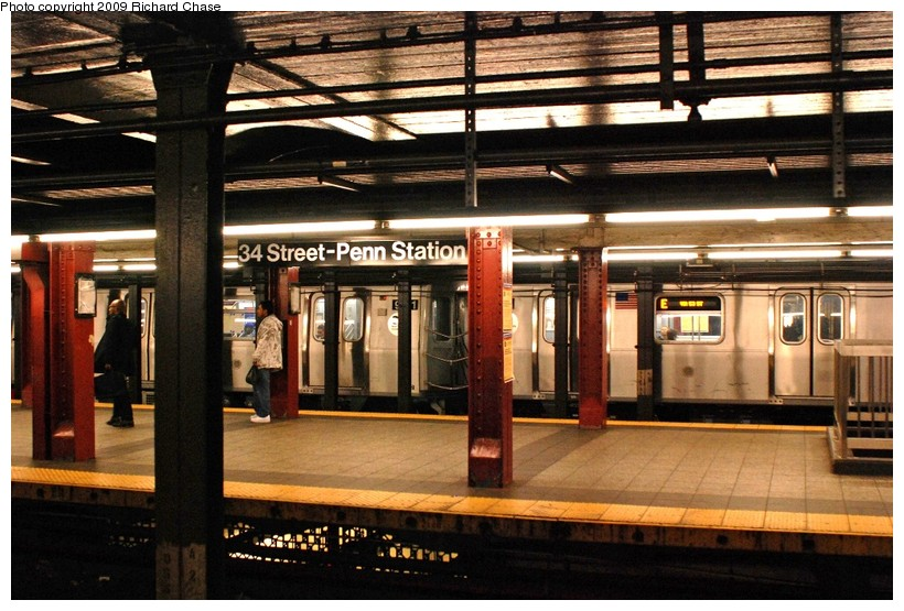 (148k, 820x555)<br><b>Country:</b> United States<br><b>City:</b> New York<br><b>System:</b> New York City Transit<br><b>Line:</b> IND 8th Avenue Line<br><b>Location:</b> 34th Street/Penn Station <br><b>Route:</b> E<br><b>Car:</b> R-160A/R-160B Series (Number Unknown)  <br><b>Photo by:</b> Richard Chase<br><b>Date:</b> 10/12/2009<br><b>Viewed (this week/total):</b> 2 / 1681