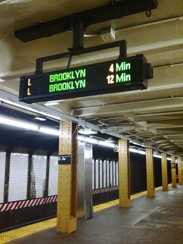 (121k, 600x800)<br><b>Country:</b> United States<br><b>City:</b> New York<br><b>System:</b> New York City Transit<br><b>Line:</b> BMT Canarsie Line<br><b>Location:</b> 6th Avenue <br><b>Photo by:</b> Bill E.<br><b>Date:</b> 10/31/2009<br><b>Notes:</b> Train arrival board<br><b>Viewed (this week/total):</b> 2 / 907