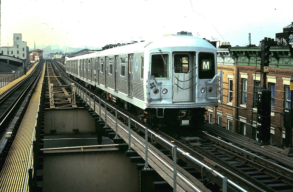 (218k, 1024x670)<br><b>Country:</b> United States<br><b>City:</b> New York<br><b>System:</b> New York City Transit<br><b>Line:</b> BMT Myrtle Avenue Line<br><b>Location:</b> Seneca Avenue <br><b>Route:</b> M<br><b>Car:</b> R-42 (St. Louis, 1969-1970)  4710 <br><b>Collection of:</b> John Barnes<br><b>Date:</b> 10/16/1988<br><b>Viewed (this week/total):</b> 0 / 1324