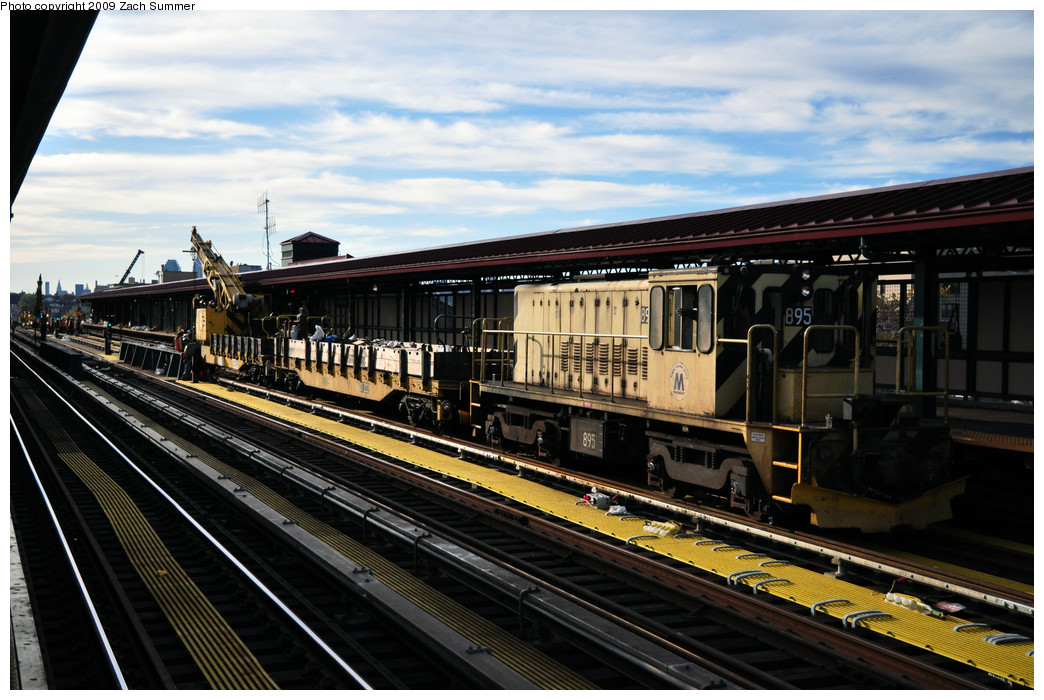 (262k, 1044x700)<br><b>Country:</b> United States<br><b>City:</b> New York<br><b>System:</b> New York City Transit<br><b>Line:</b> IRT Flushing Line<br><b>Location:</b> 74th Street/Broadway <br><b>Route:</b> Work Service<br><b>Car:</b> R-77 Locomotive  895 <br><b>Photo by:</b> Zach Summer<br><b>Date:</b> 10/25/2009<br><b>Viewed (this week/total):</b> 2 / 327